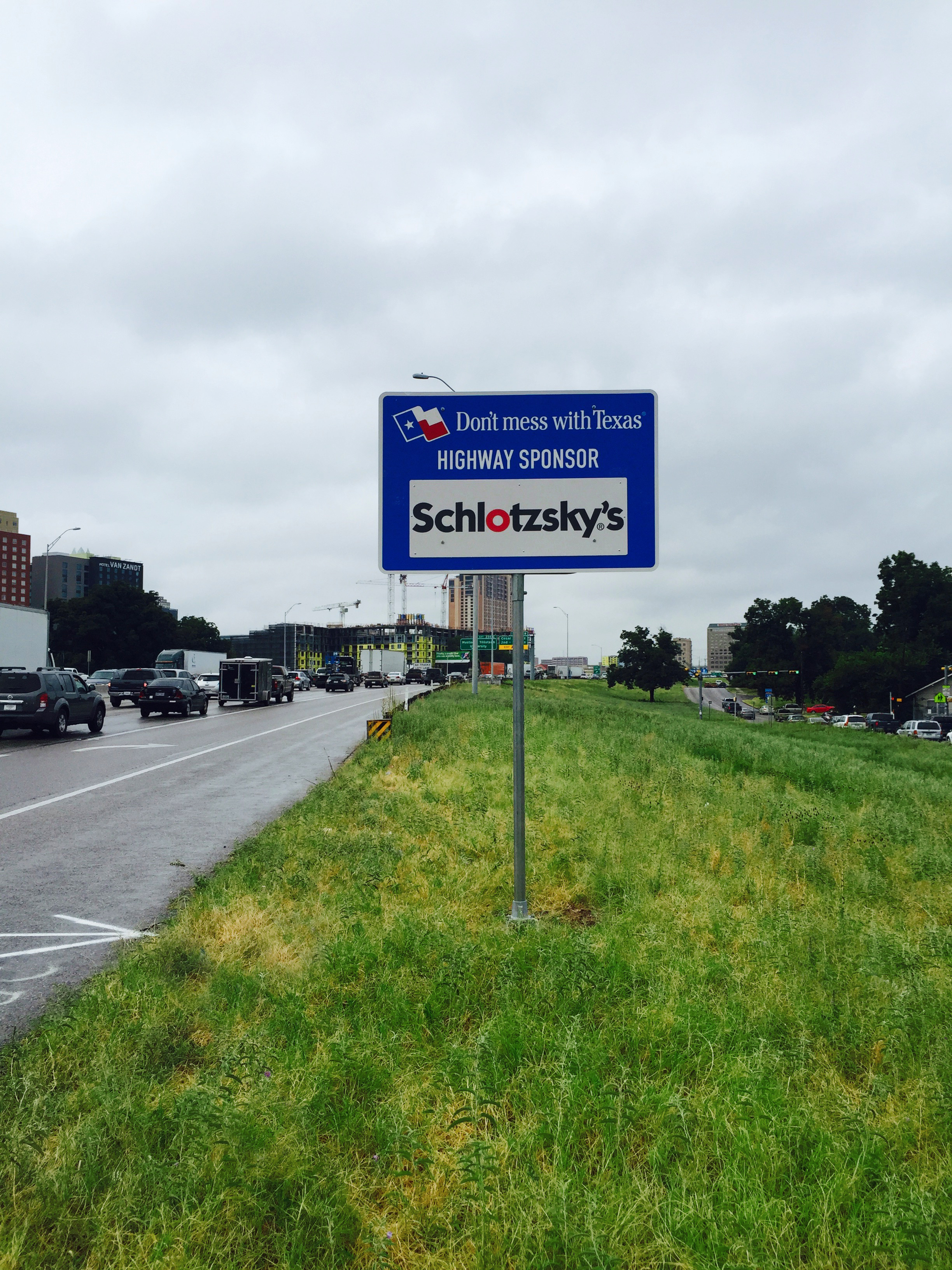 Schlotzsky's Texas Sponsor A Highway Program sign